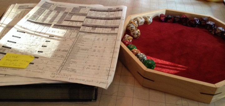 Dice tray with dice, and a Pathfinder RPG character sheet.