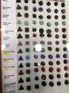 A display case filled with gemstone dice